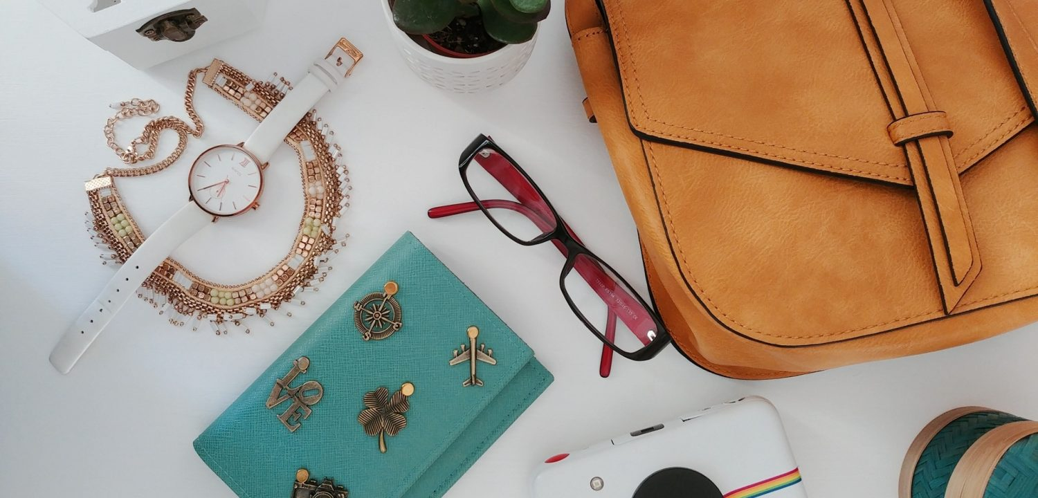 Travel accessories such as passport bag, camera, glasses, watch